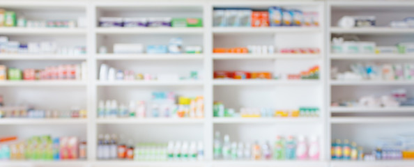 Poster Apotheek Pharmacy drugstore blur abstract backbround with medicine and healthcare product on shelves