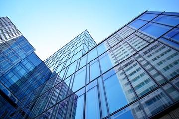 Foto op Canvas Aan het plafond Blue clean glass wall of modern skyscraper