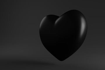glossy black heart hanging in the air on a dark background