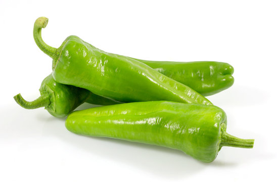 Green vegetables. Organic fresh long green peppers or green chilli horizontal isolated on white background, with clipping path.