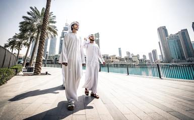 Three arabic business men spending time in Dubai