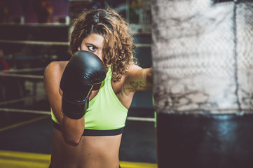 Boxer woman training at the heavy bag