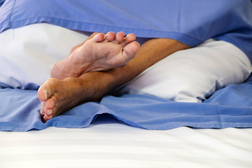 Feet of Paralysis Patients on the Hospital Bed.