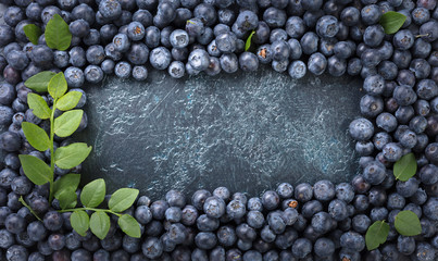 Ripe and juicy fresh picked blueberries closeup. Wall mural