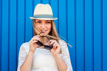 Cute hipster girl over blue background
