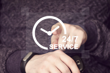 Wall Mural - Businessman presenting 24 hours service concept on a blurred background