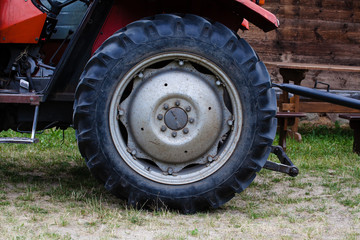 A large wheel with a tractor cover. Agricultural machinery