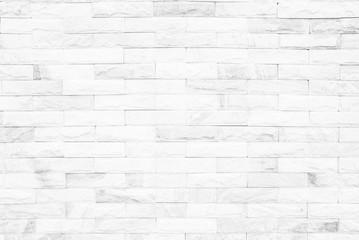 Cream and white brick wall texture background. Brickwork or stonework flooring interior rock old...