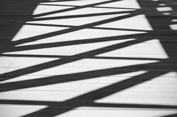 Abstract Shadows of Lines and Figures on a Road as Background or Texture, Black and White Picture