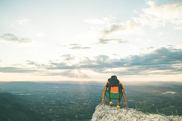 Man on top of a mountain looking at the view