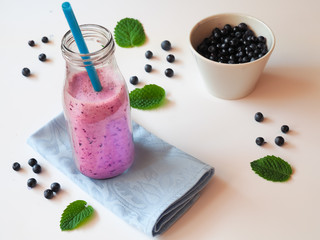 Blueberry smoothie in a glass bottle