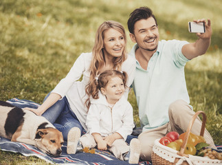 Father Takes Photo of Family on Summer Picnic.