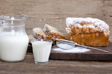 Aluminium Prints Bakery sweet bread with powdered cigars and milk
