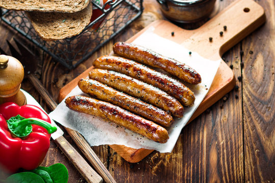 Pork chipolata. Close-up view of fried sausages. Meat dish