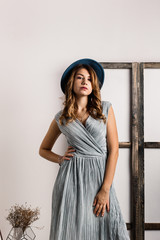 Young pretty girl in blue hat