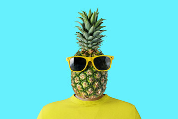 A man with a pineapple instead of head. Minimal summer concept.