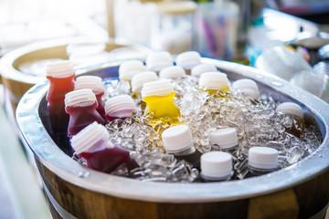Cool fruit juice in a wooden bucket.