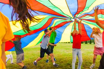Unlimited joy under rainbow parachute