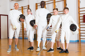 adult and teen fencers with rapiers
