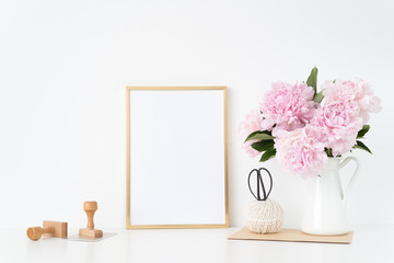 Gold portrait frame mock up with a pink peonies with stamps beside the frame, overlay your quote or design, great for small businesses, lifestyle bloggers and social media campaigns