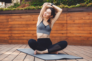 Portrait of a pretty young fitness girl doing stretching
