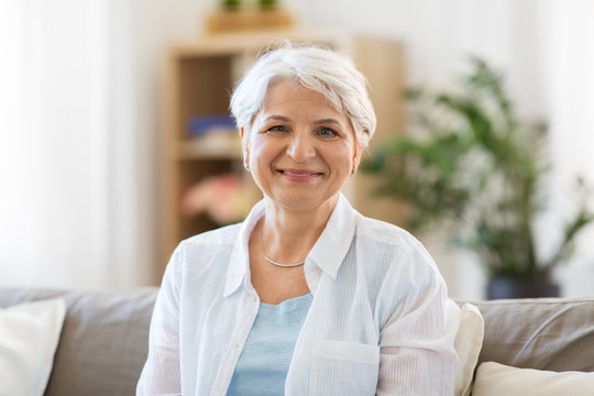 emotion, age and people concept - portrait of happy senior woman laughing