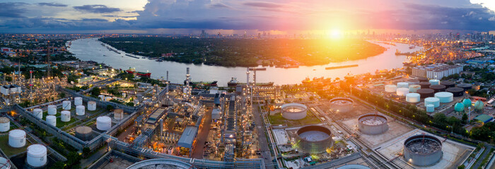 Aerial view of twilight of oil refinery ,Shot from drone of Oil refinery and Petrochemical plant at dusk .