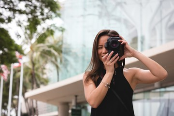 Woman clicking photo with digital camera