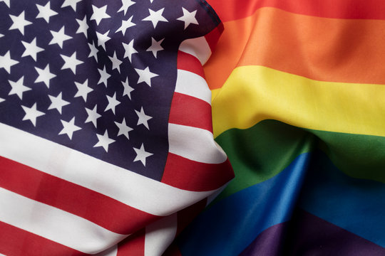 American stars and stripes flag alongside a gay Pride LGBT rainbow flag