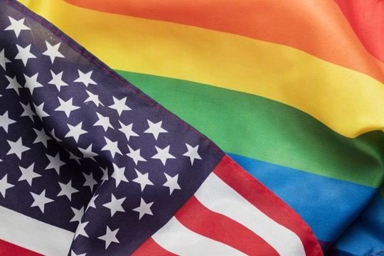 American stars and stripes flag alongside a gay Pride LGBT rainbow flag