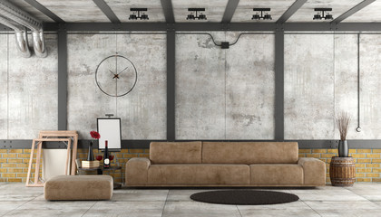 Living room in a loft with concrete and brick wall