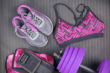 Purple dumbbell, sport bra and sneaker, sport equipments, fitness items, top view