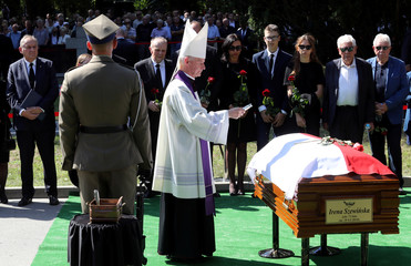 People attend the funeral of Polish athlete Irena Szewinska in Warsaw