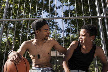 Afro young brothers play basketball