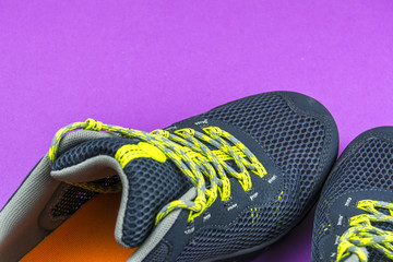 Men's summer grey sneakers on a purple background