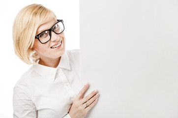 Portrait of pretty emotional woman dressed in white shirt with eyeglasses with copyspace on light background