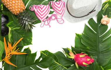 Still life photo holiday concept with border of monstera vine leaf and bikini, hat, fruit and flower top view flat layout mockup