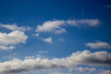 Clouds against blue sky as background