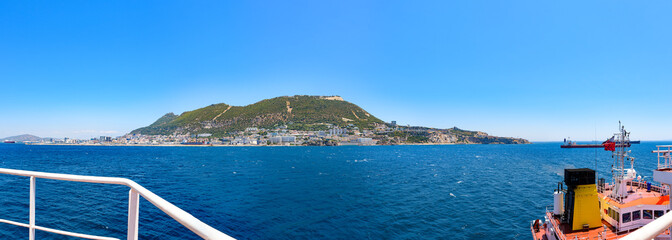 Day view to Gibraltar rock from sea, architecture of Gibraltar