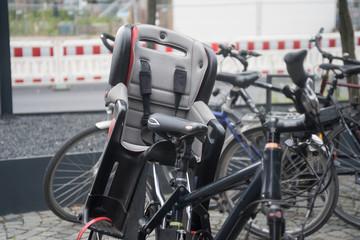 empty children seat bike and bike parking