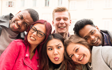 happy international team of college students of multi-ethnic origins, best friends making funny faces for a selfie photo.