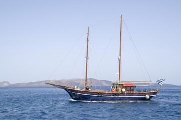 Wooden ship for trip near Santorini island
