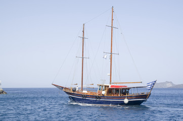 Wooden ship for trip near Santorini island