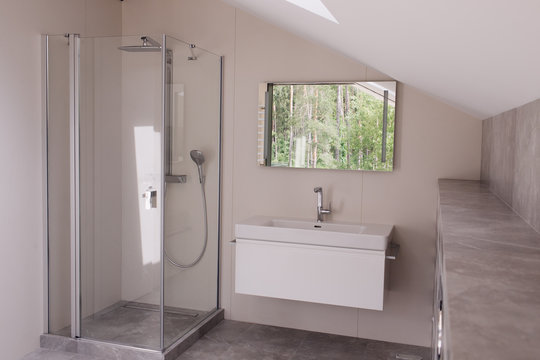bathroom with transparent shower and washbasin
