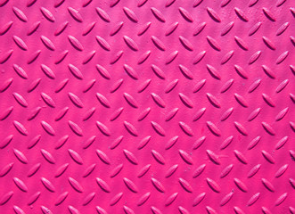 pink painted industrial steel sheeting with grid textured flooring pattern