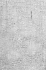 Full frame background of a lacy textile or curtain in black and white
