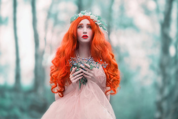 Young frightened woman looks like a doll in mystery world with very long hair in pink dress on blue background. Beautiful girl with pale skin and red lips. Renaissance mystery woman in spring forest