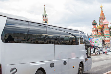 Excursion bus moves in the center of Moscow near the Kremlin.