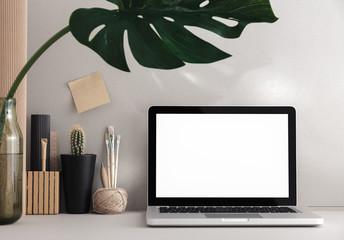 Stylish desk with laptop mock up. Minimal workspace desk of designer.