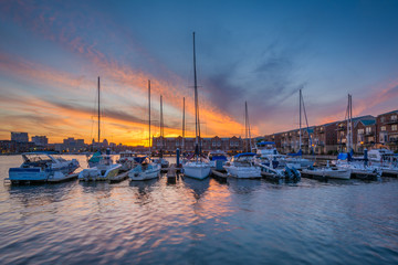 Wall Mural - Sunset over a marina in Canton, Baltimore, Maryland